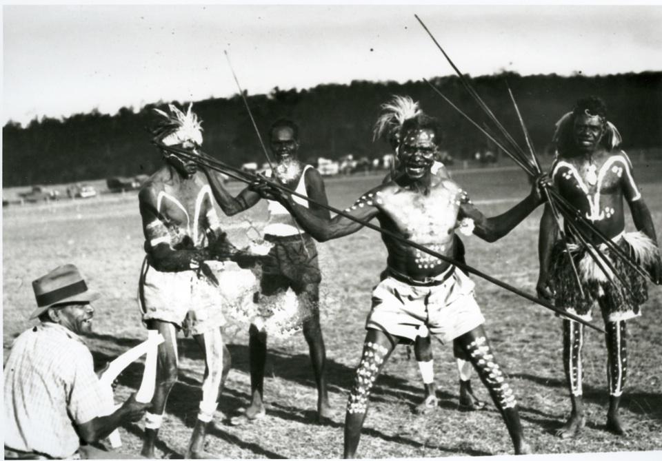 Decorated men dancing at Barambah Aboriginal Settlement c1920