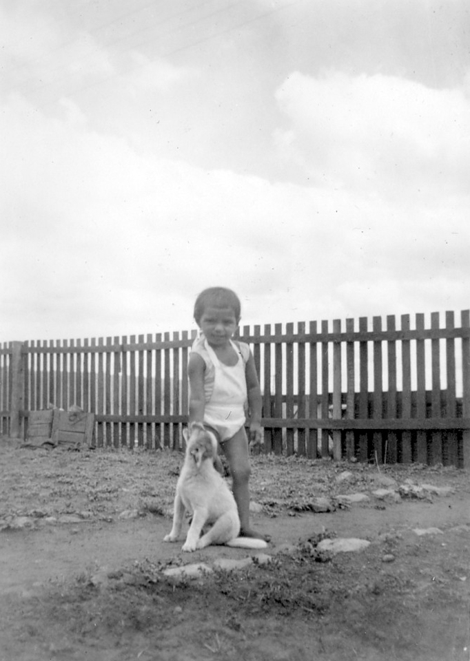 Child with dog at Cherbourg c1930