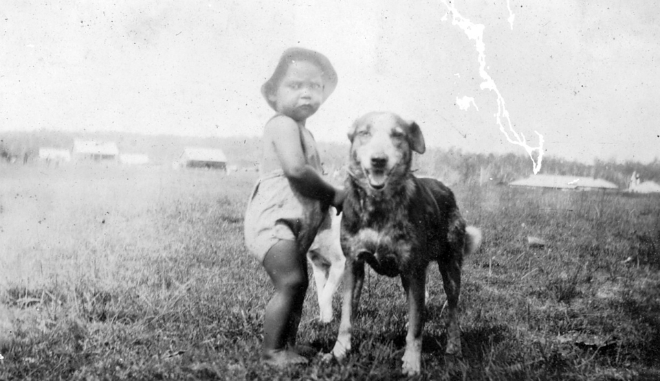 Toddler and dog at Cherbourg c1930