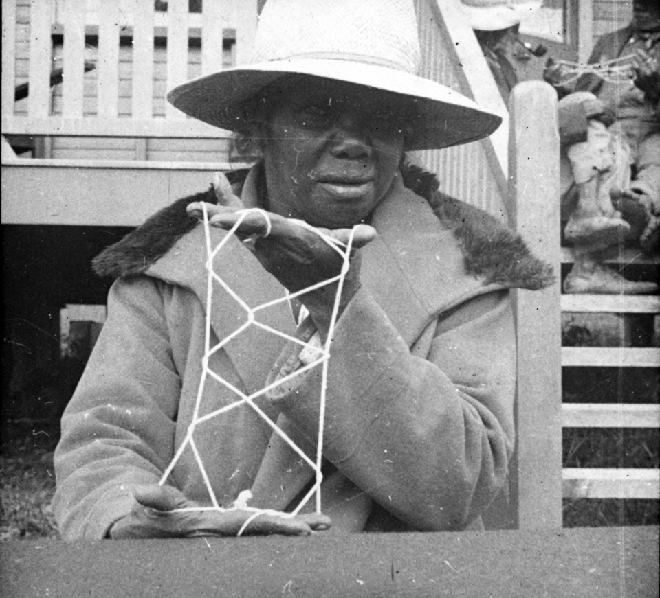 Woman with string design at Cherbourg Aboriginal Settlement 1934