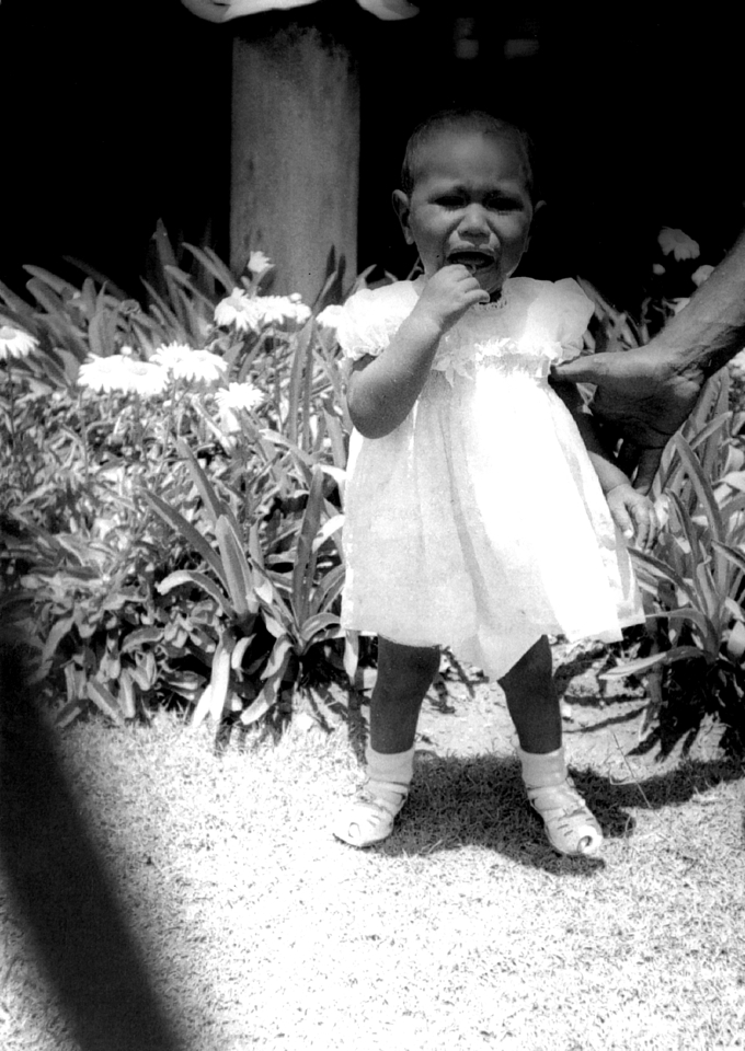 Baby in garden at Cherbourg Hospital c1961