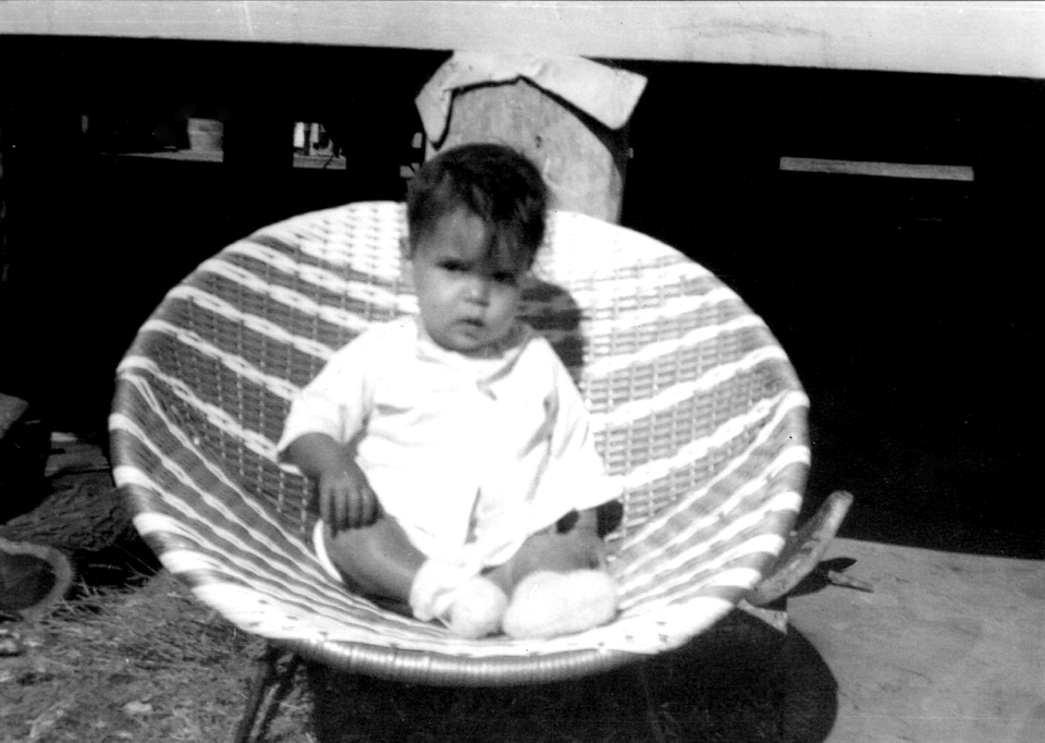 Child sitting in chair at Cherbourg Hospital c1961