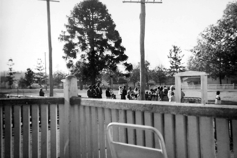 Church service outside hospital grounds at Cherbourg c1961