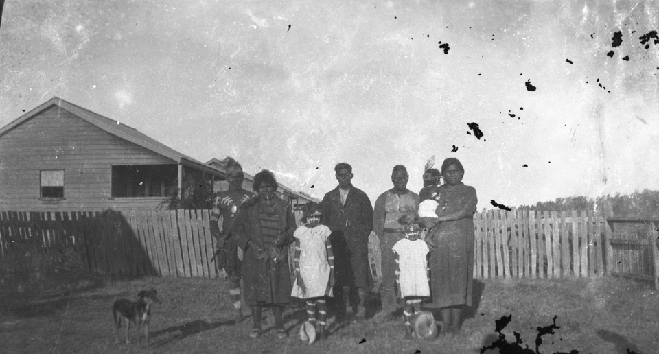 Family at front of cottages at Cherbourg 1934