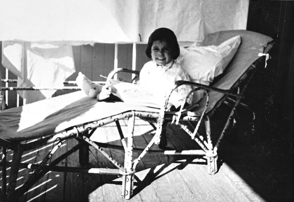 Girl on veranda at Cherbourg Hospital c1962