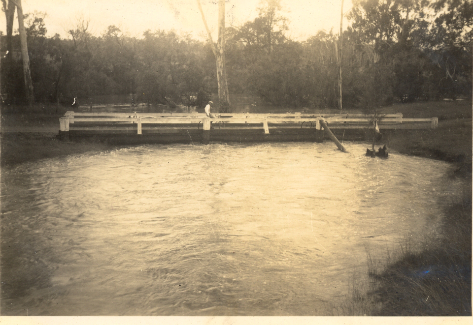 Low bridge across gulley in flood at Cherbourg c1935