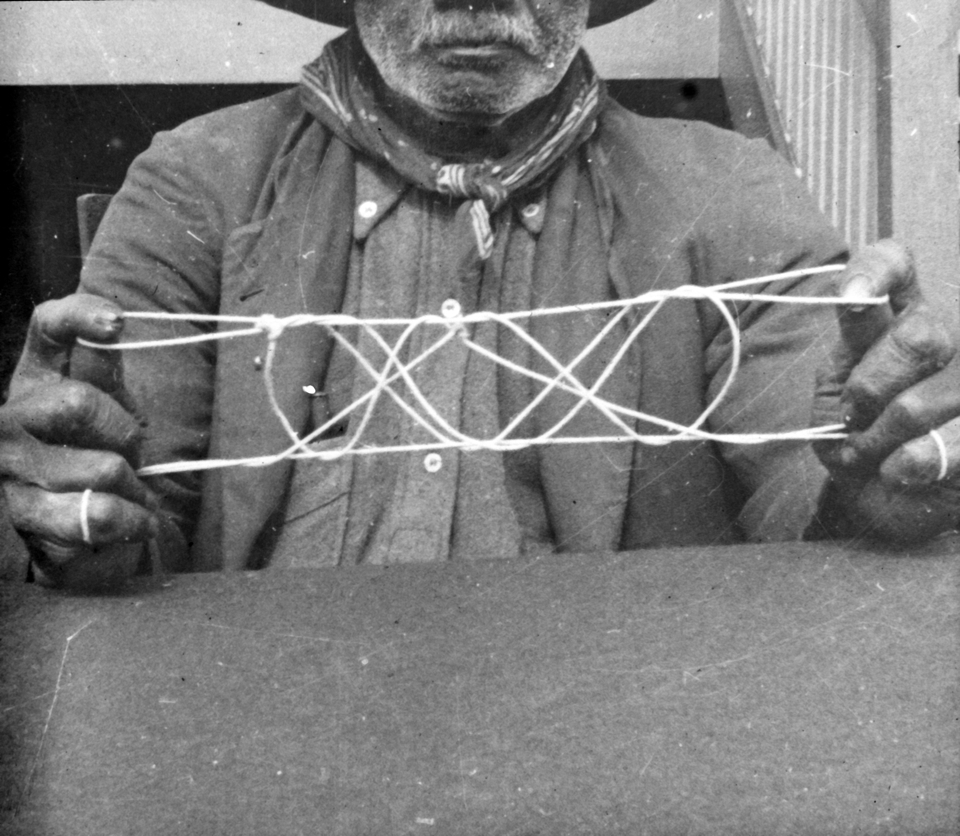 Man with string design at Cherbourg 1934