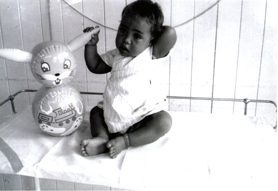 Michael Wragge with toy at Cherbourg Hospital c1961