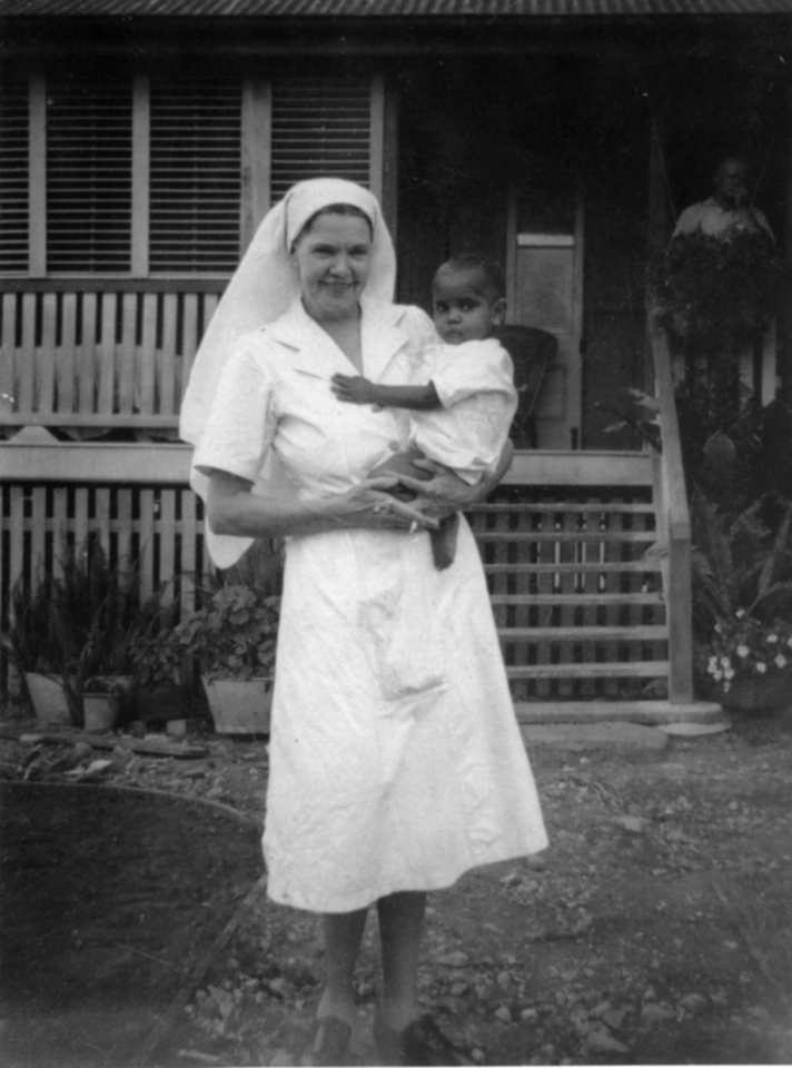 Nurse holding baby at Cherbourg c1962
