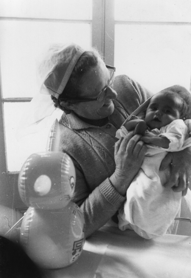 Nurse with baby at Cherbourg Hospital c1961