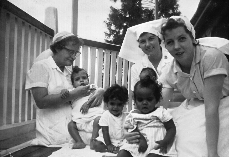 Nurses and babies on veranda at Cherbourg Hospital c1961