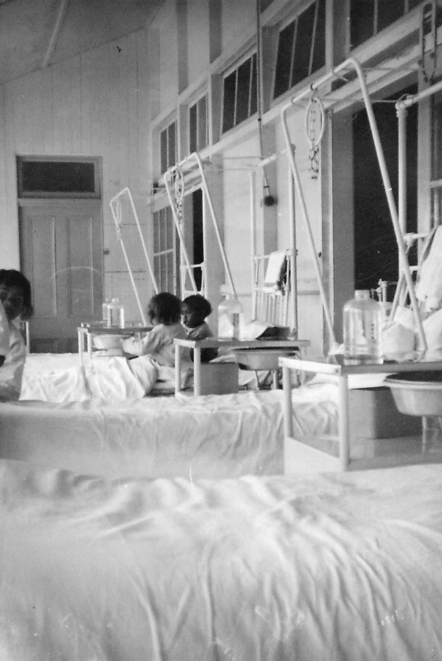 Patricia and Paula Douglas on verandah of the Cherbourg Hospital c1961
