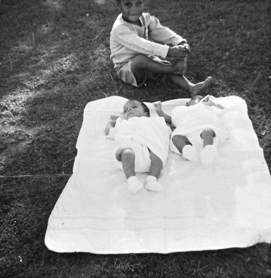 Twins on rug at Cherbourg Hospital c1961