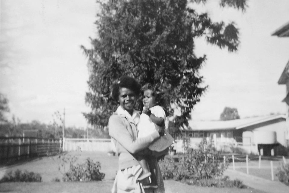 Woman with baby at Cherbourg Hospital c1961
