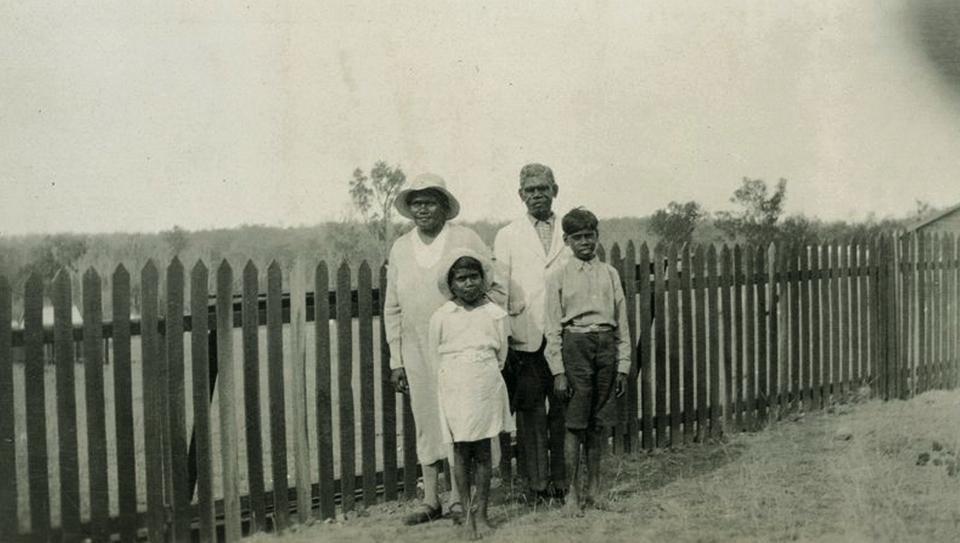 Group in yard at AIM church at Barambah Aboriginal Settlement c1938