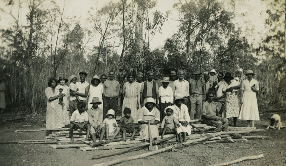 Group with wood for open-air cathedral at Barambah Aboriginal Settlement c1929
