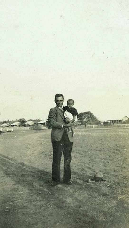 Man and baby at Barambah Aboriginal Settlement c1930