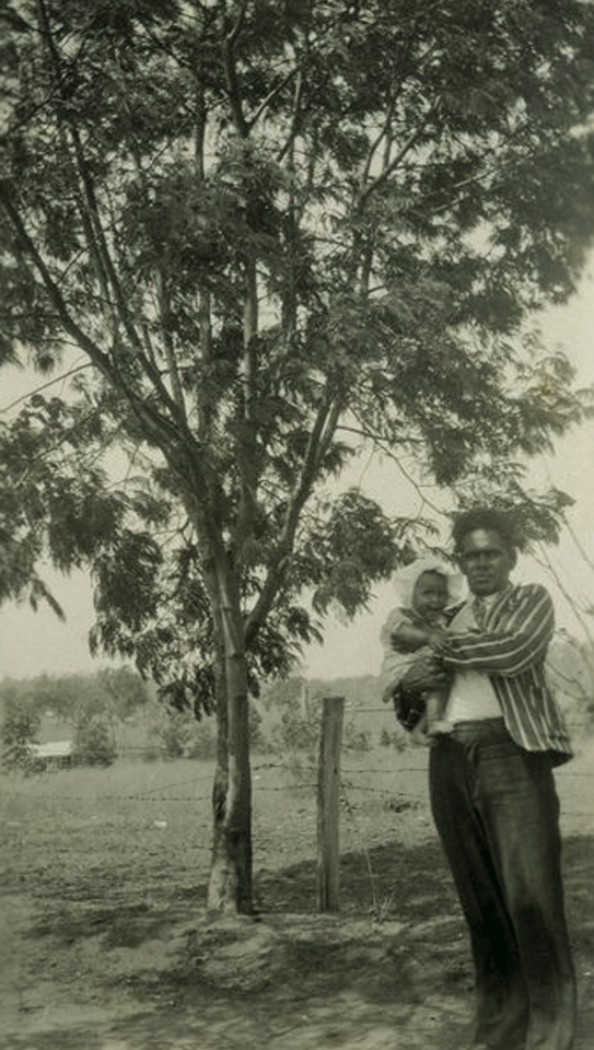 Man and child at Barambah Aboriginal Settlement c1930