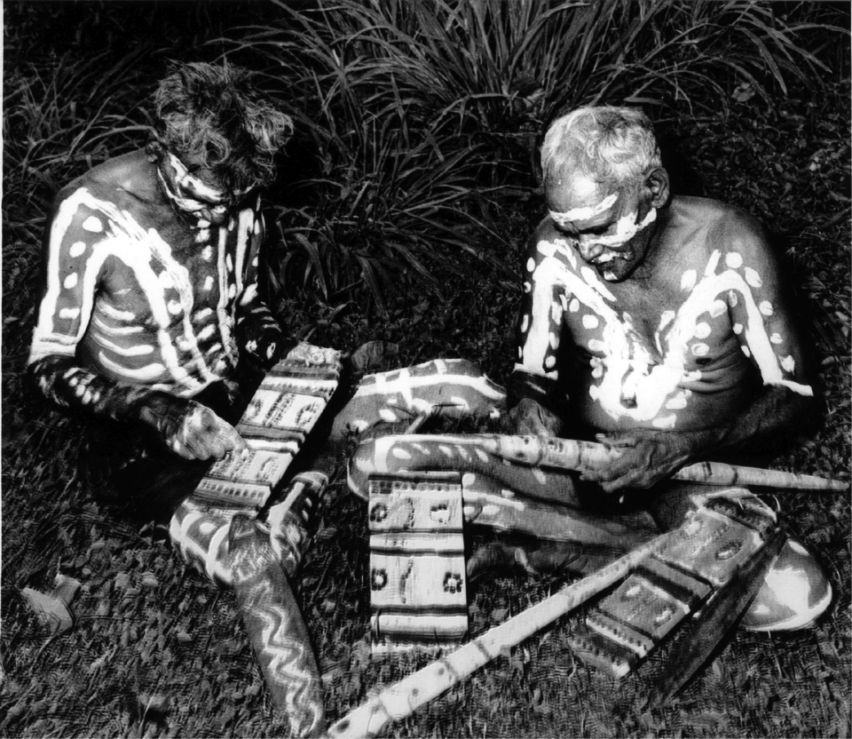 Decorated men painting objects at Cherbourg Aboriginal Settlement c1920