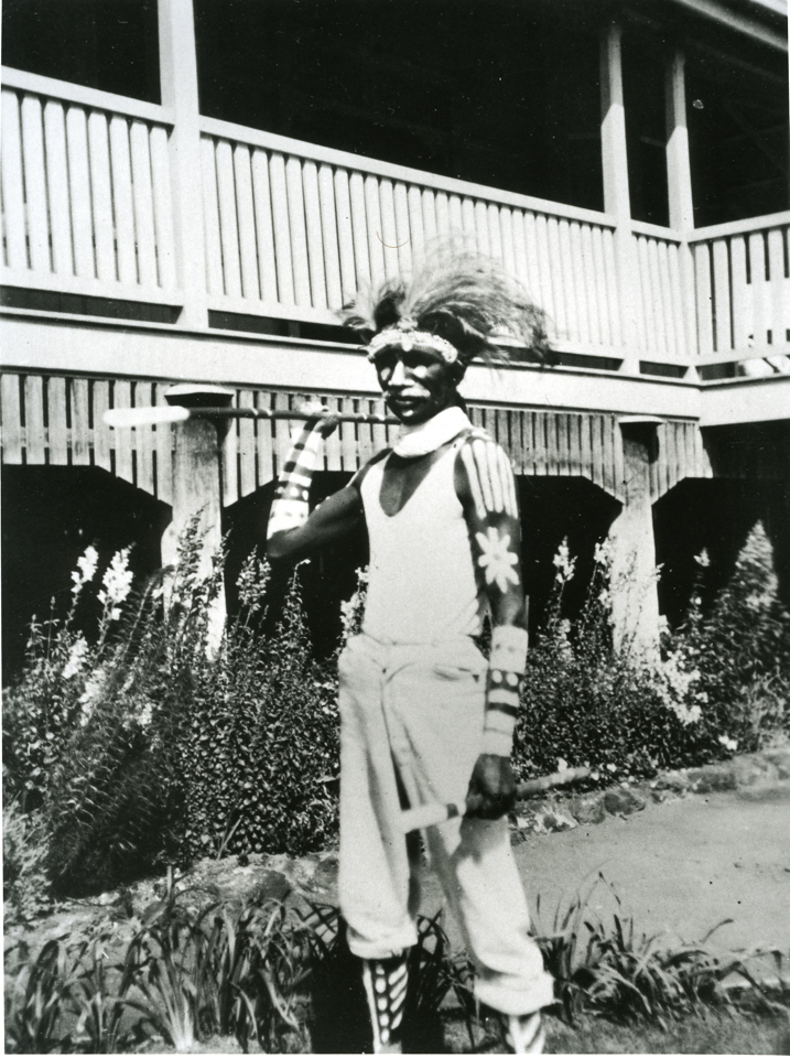 Man holding spear at Cherbourg Aboriginal Settlement c1930