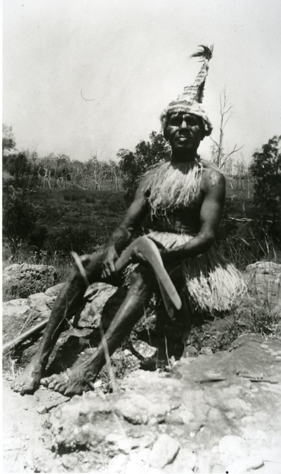 Man with boomerang at Barambah Aboriginal Settlement c1920