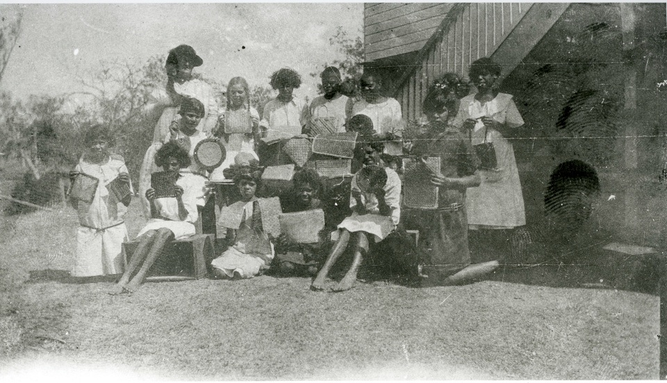 Barambah Aboriginal Settlement schoolgirls with samples of handicraft c1926
