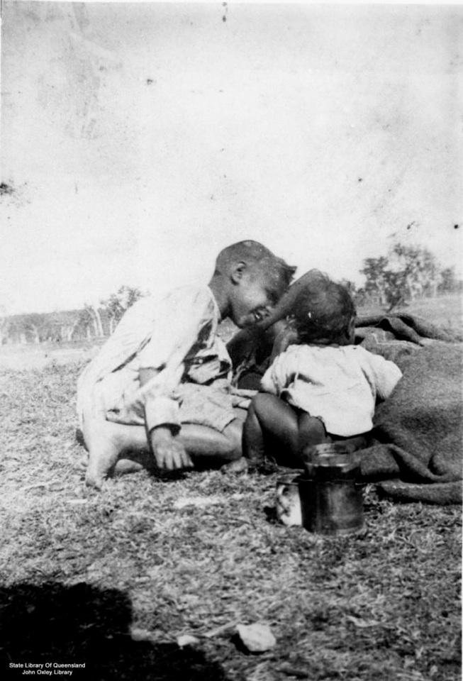 Children with blanket at Barambah Aboriginal Settlement 1905
