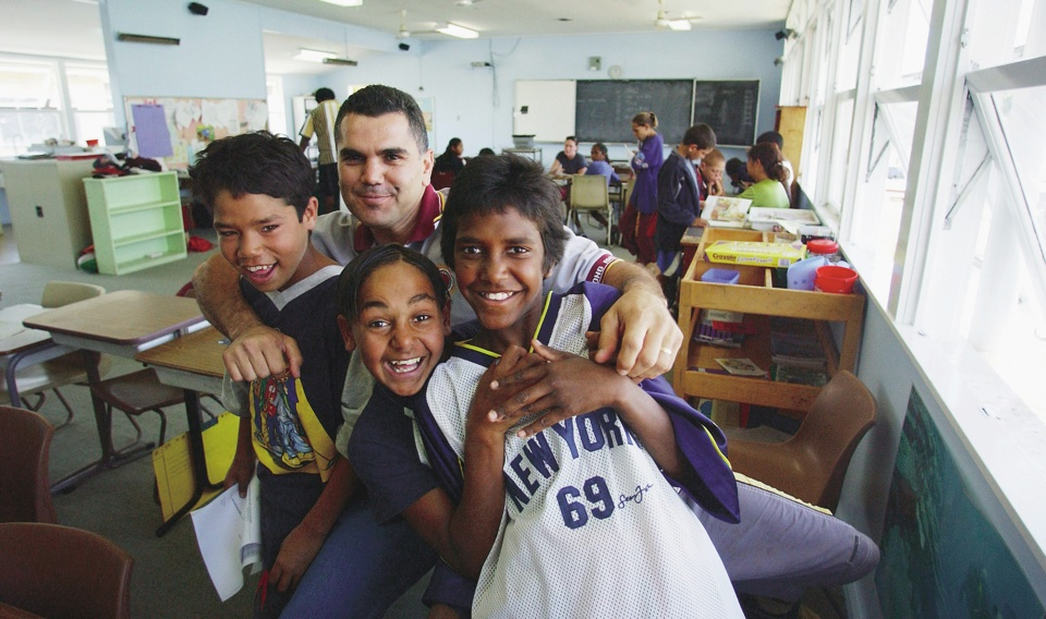 Chris-Sara-and-pupils-at-Cherbourg-State-School_1998