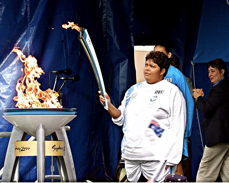 Edna-Malone-lights-cauldron-at-Cherbourg-leg-of-Olympic-Torch-Relay_2000