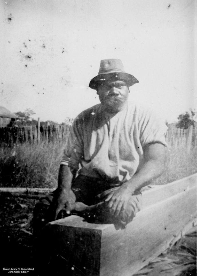 Man on beam at Barambah Aboriginal Settlement 1905