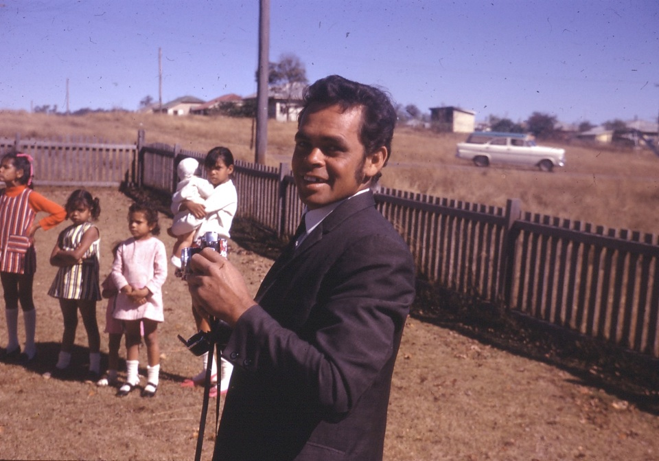 Man with children at AIM Church at Cherbourg c1960