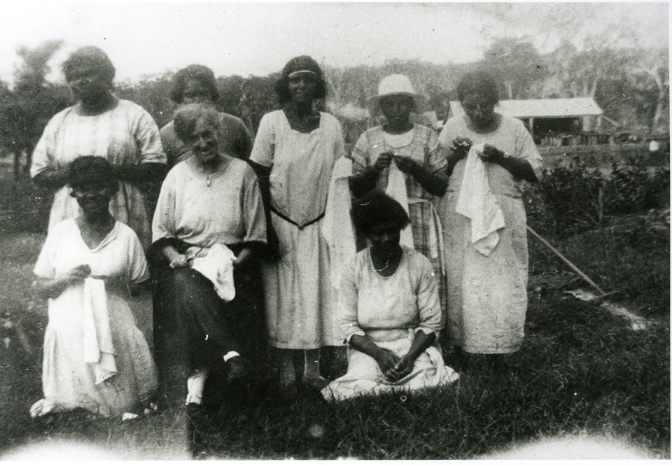 Mrs Semple and Aboriginal women with sewing at Barambah Aboriginal Settlement c1926