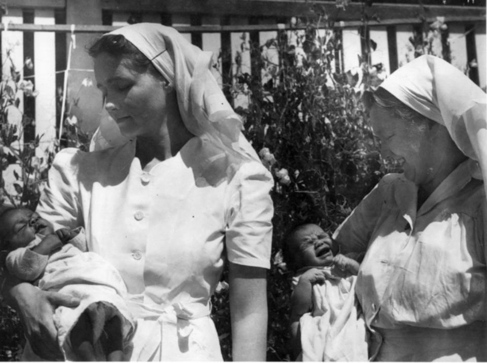 Nurse and Matron Rynne holding Richard Hooper Coleman at Cherbourg Hospital 1961
