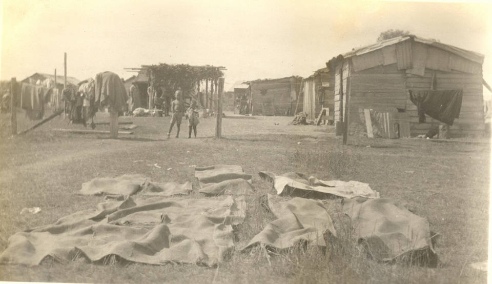 Shelters and children in the Camp at Cherbourg Aboriginal Settlement c1930