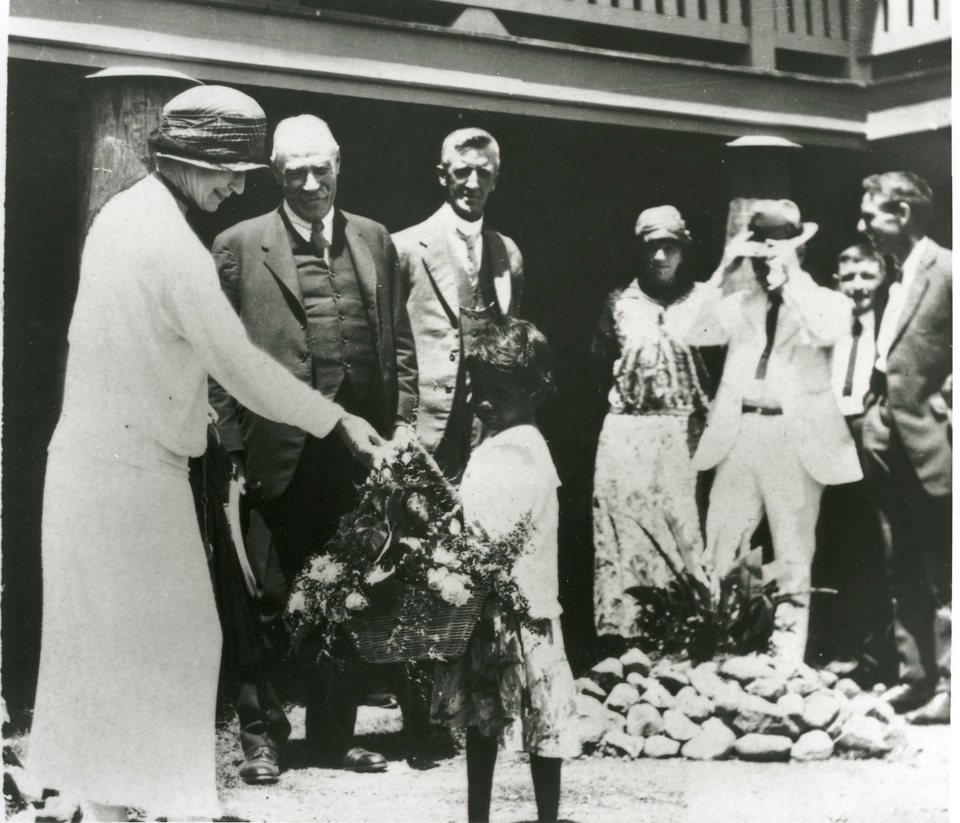 Sir John and Lady Goodwin accepting flowers at Cherbourg Aboriginal Settlement 1928