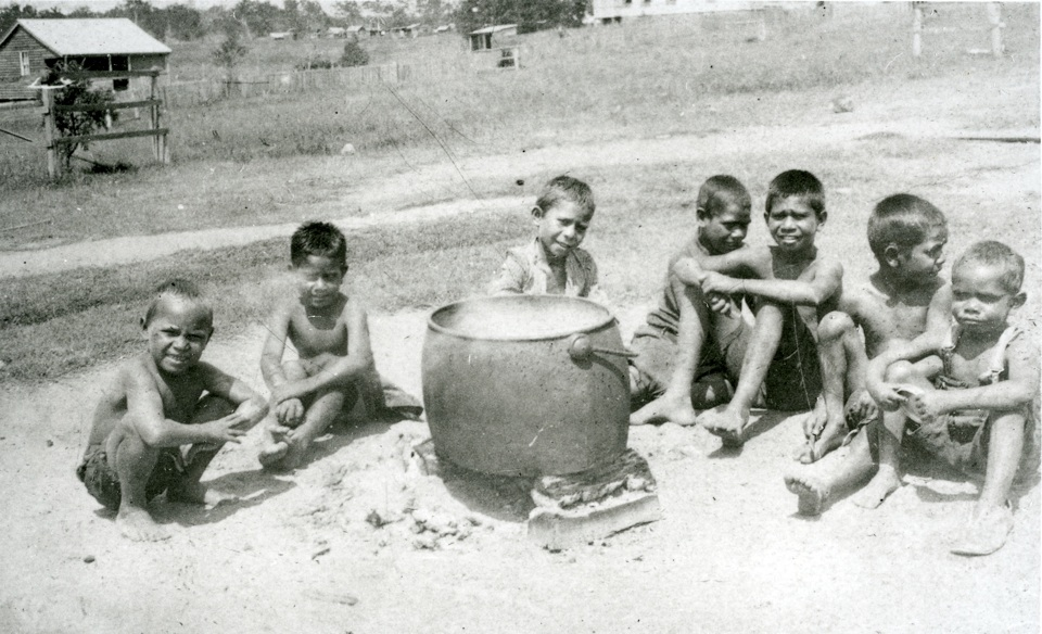 Sitting around a cooking pot at the Boys Dormitoty in Cherbourg c1943