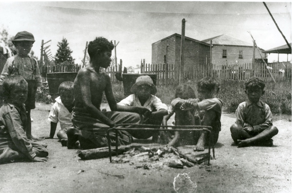 Sitting around an open fire at the Boys Dormitoty in Cherbourg c1943