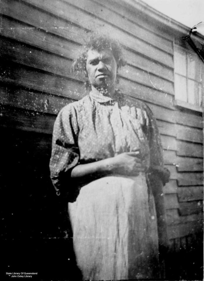 Woman outside building at Barambah Aboriginal Settlement 1905