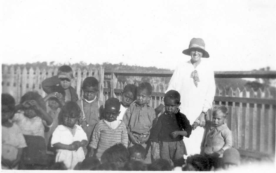 Woman with children at the Boys Dormitory at Cherbourg c1930s