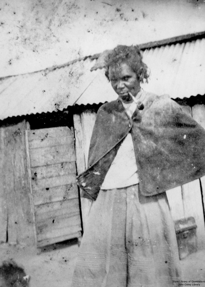 Woman with pipe at Barambah Aboriginal Settlement 1905